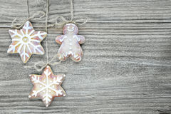 Christmas background. Three gingerbread cookies on the wooden background Stock Photo