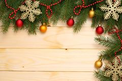 Christmas background. Top view with copy space. fir tree with cone on light wooden background stock photos