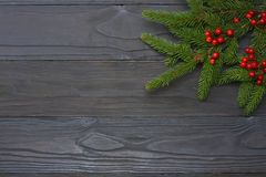 Christmas background. Top view with copy space. fir tree on dark wooden background royalty free stock photography