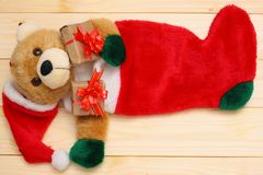 Christmas background. Top view with copy space. teddy bear on light wooden background royalty free stock photo