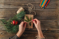 Christmas background. Top view of female hands holding New Year Stock Photo