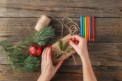 Christmas background. Top view of female hands holding New Year Stock Image