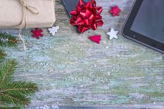 Christmas background with touch pad,christmas branch, red bow Stock Image