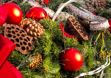 Christmas background with toys on fir tree. Christmas background with toys, cake and fir-cones on fir tree branches with shallow depth of field royalty free stock photos