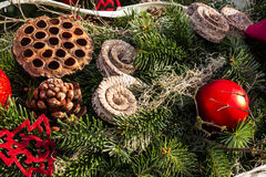 Christmas background with toys on fir tree. Christmas background with toys, cake and fir-cones on fir tree branches with shallow depth of field Stock Photos
