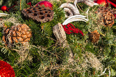 Christmas background with toys on fir tree. Christmas background with toys, cake and fir-cones on fir tree branches with shallow depth of field royalty free stock photo