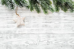 Christmas background. Toys and spruce branches on light wooden background top view copyspace Royalty Free Stock Photography
