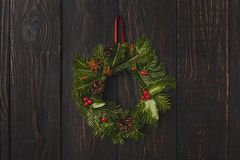 Christmas wreath decoration on rustic wood background. Stock Images