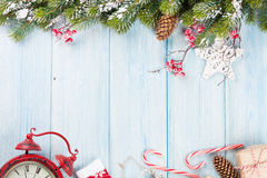 Christmas background with tree, alarm clock and gift Royalty Free Stock Image