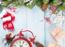 Christmas background with tree, alarm clock and gifts Royalty Free Stock Images
