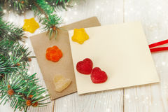 Christmas background.Tree branch,jujube and empty cards.wooden table