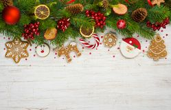 Christmas background with tree branches, ball toys, stars, gingerbread cookies royalty free stock photos