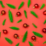 Christmas background with tree branches and decorations on red Stock Photography