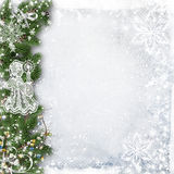 Christmas background with tree branches, snow and angel Stock Photo