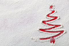 Christmas Background. Christmas tree on flour background. White flour looks like snow. Top view