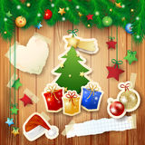 Christmas background with tree, gifts and paper elements Royalty Free Stock Image