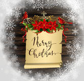 Christmas background with tree. Christmas background with paper scroll ribbon and lights on a wooden wall with handwritten Merry Christmas with poinsettia and Royalty Free Stock Images