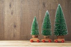 Christmas background with tree on toy car. On wooden table royalty free stock image