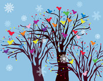 Christmas background with trees, birds and snow Stock Image