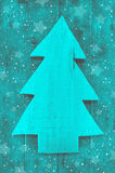 Christmas background in turquoise green color of a handmade carv Royalty Free Stock Photography
