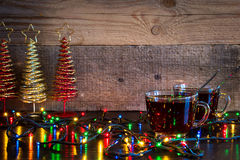 Christmas background with two cups of tea and lights on wood tex Royalty Free Stock Photo