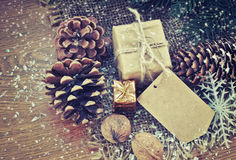 Christmas background with  two gift, fir tree cone Royalty Free Stock Photo
