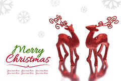 Christmas background with two red deer on white background Stock Images