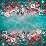 Christmas background with various red vintage festive decoration on turquoise background, top view. Frame royalty free stock photo