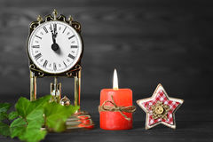 Christmas background with vintage clock, candle and star ornament Stock Photography