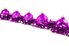Christmas background with violet balls and garland Stock Photography