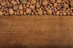 Christmas background with walnuts hazelnuts and almonds on wood Royalty Free Stock Photography