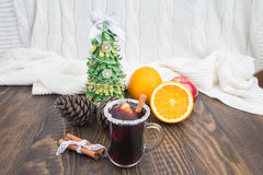 Christmas background with warm mulled wine, handmade Christmas tree and a knitted blanket Stock Image