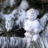 Christmas background with white angel. On snowy fir tree stock photo
