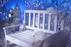 Christmas background. White bench near silver tree Stock Photo