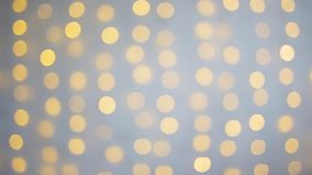 White brick wall and lights with blur effect stock footage