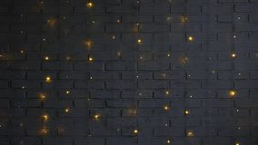 White brick wall with lights in darkness stock footage