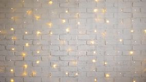 White brick wall with shiny lights stock video