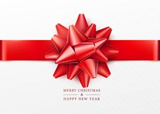 Christmas background. White gift box with red bow and horizontal ribbon. Top view. Greeting text sign. Merry xmas and happy new year. Vector illustration