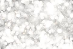 Christmas background. White glitter christmas abstract snow with blur bokeh light background Stock Photos