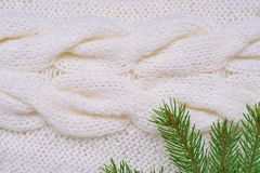 Christmas background white knitting pattern and fir branches Royalty Free Stock Image