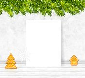 Christmas background with white paper blank, pine branches, gingerbread cookies and snowflafe vector stock illustration