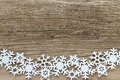 Christmas background with white snowflakes on a wooden backgrou royalty free stock images