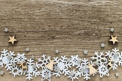 Christmas background with white snowflakes and wooden figures stock photo