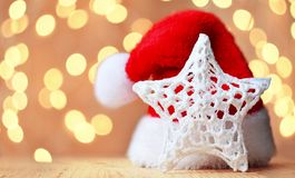 Christmas background with star and Santa Claus hat royalty free stock photos