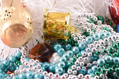 Christmas background with wine bottle and pearls Stock Photos