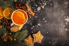 Christmas background. Sea-buckthorn tea with ginger and citrus. Christmas background. Winter hot berry drink. Sea-buckthorn tea with ginger and citrus on a dark royalty free stock images