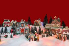 Christmas background of winter miniature scenery with kids. Kid gospel choir singing and reads bible in the middle of Christmas village. Winter fairytale royalty free stock photography