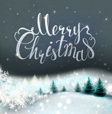 Christmas background with winter snowy landscape and fir-trees. Holiday lettering. Royalty Free Stock Photography