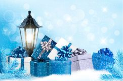 Christmas Background With A Lantern And Presents. Royalty Free Stock Photography