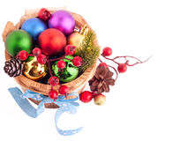 Christmas background with wood bucket, cones, color balls and be Royalty Free Stock Image